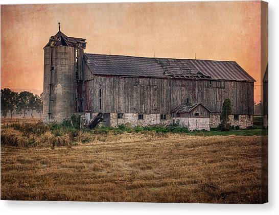 Canvas Print featuring the photograph Old Country Barn by Garvin Hunter