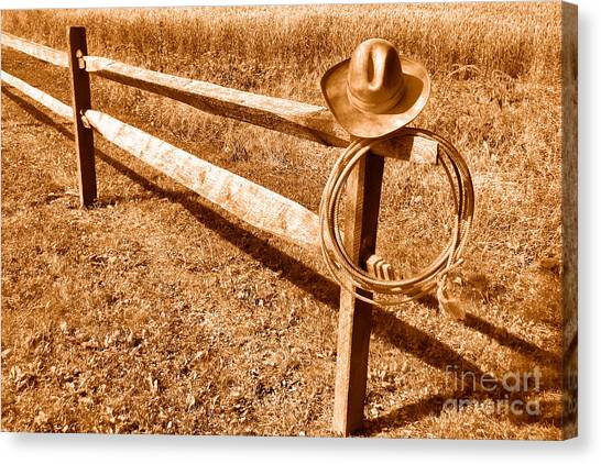 Lassos Canvas Print - Old Cowboy Hat On Fence - Sepia by Olivier Le Queinec