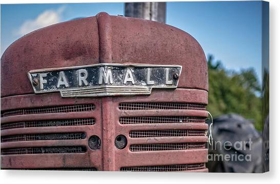 John Deere Canvas Print - Old Farmall Tractor Grill And Nameplate by Edward Fielding