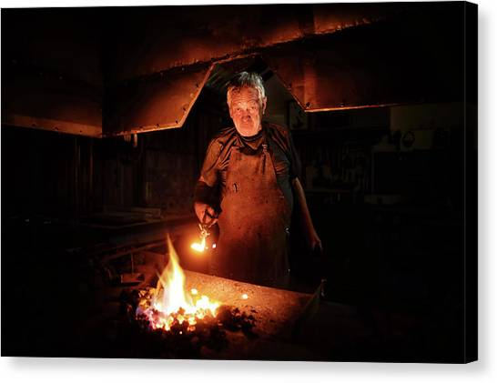 Old Fashioned Canvas Print - Old-fashioned Blacksmith Heating Iron by Johan Swanepoel