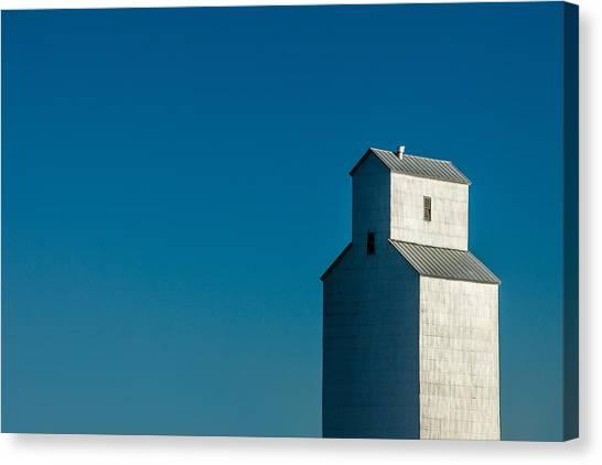 American Steel Canvas Print - Old Grain Elevator Against Steel Blue Sky by Todd Klassy