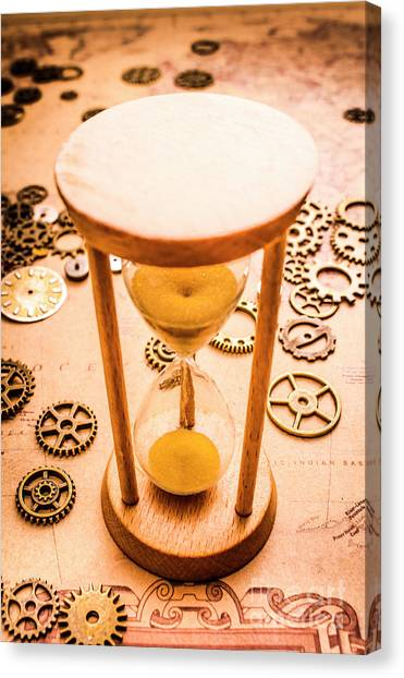 Machinery Canvas Print - Old Hourglass Near Clock Gears On Old Map by Jorgo Photography - Wall Art Gallery