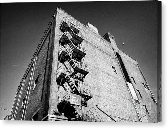 Fireescape Canvas Print - Old Metal Fire Escape On Side Of Red Brick Warehouse Building Liverpool  by Joe Fox