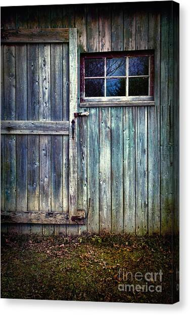 Old Shed Door With Spooky Shadow In Window Canvas Print