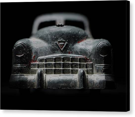 Old Silver Cadillac Toy Car With Specks Of Red Paint Canvas Print