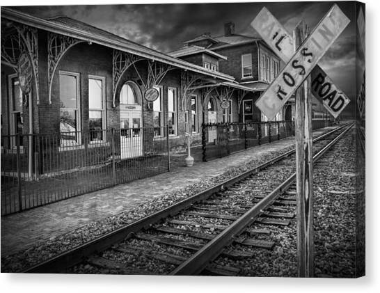 Old Train Station With Crossing Sign In Black And White Canvas Print