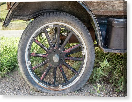 Old Truck Tire In Rural Rocky Mountain Town Canvas Print