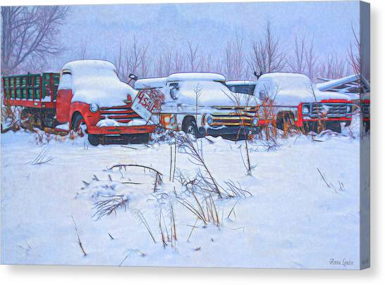Old Trucks In Snow Canvas Print