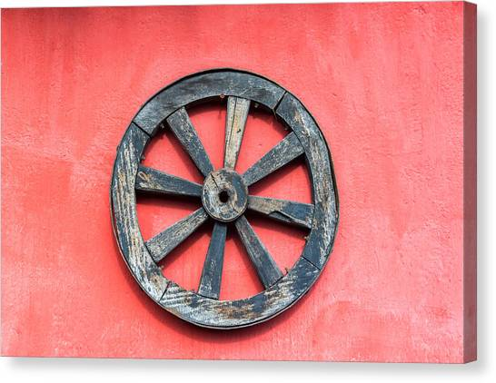 Cotopaxi Canvas Print - Old Wagon Wheel And Red Wall by Jess Kraft