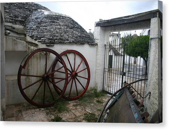 Old Wagon Wheels Canvas Print by Dennis Curry