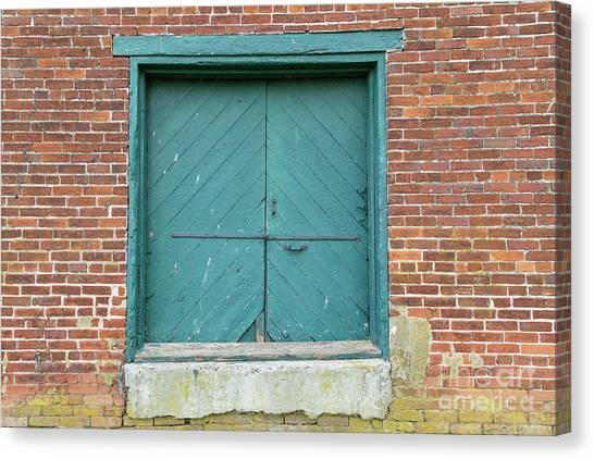 Old Warehouse Loading Door And Brick Wall Canvas Print