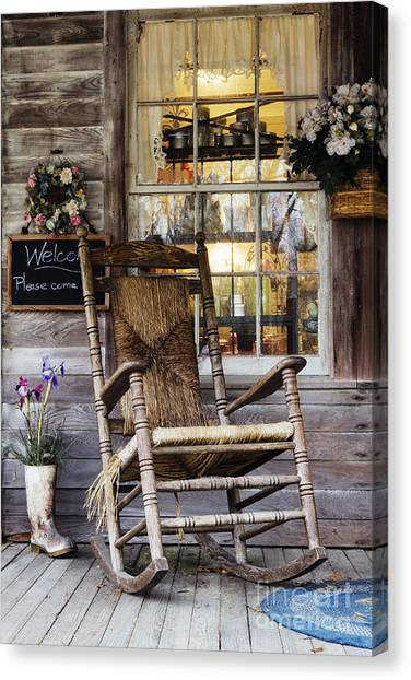 Old Wooden Rocking Chair On A Wooden Porch Canvas Print by Jeremy Woodhouse