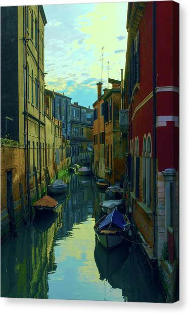 one of the many Venetian canals at the end of a Sunny summer day Canvas Print