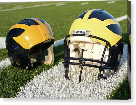 One Old, One New Wolverine Helmets On The Field Canvas Print