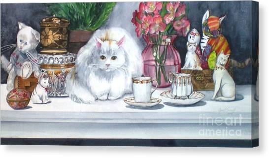 One Real Cat And Several Faux Kitties Canvas Print