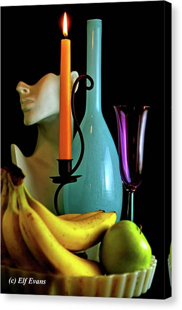 Orange Candle And Blue Bottle Canvas Print