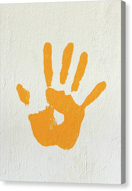 Orange Handprint On A Wall Canvas Print