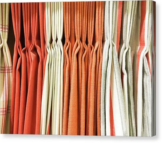 Clothing Store Canvas Print - Orange Textiles by Tom Gowanlock