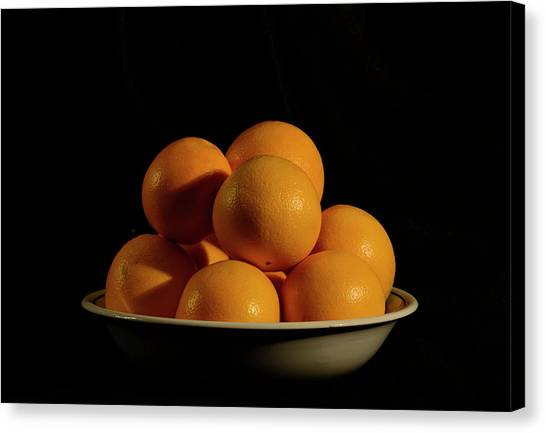 Canvas Print featuring the photograph Oranges by Angie Tirado