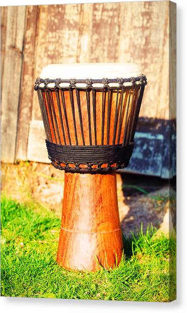 Djembe Canvas Print - Original African Djembe Drum With Leather Lamina On Green In Sun Light. by Jozef Klopacka
