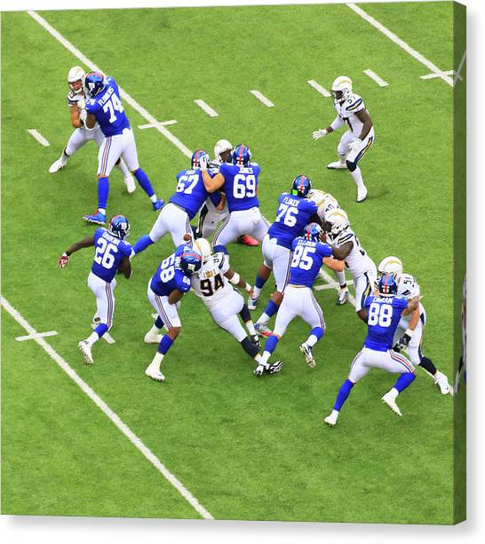 Los Angeles Chargers Canvas Print - Orleans Darkwa Runs Through The Opening by Allen Beatty