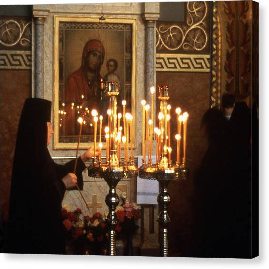 Orthodox Church Georgia Nuns Lighting Prayer Candles Canvas Print by Richard Singleton