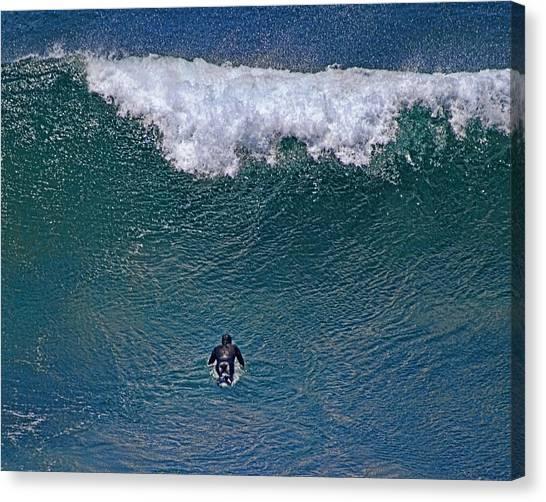 Padding Into The Mavericks Canvas Print by Chuck Brittenham