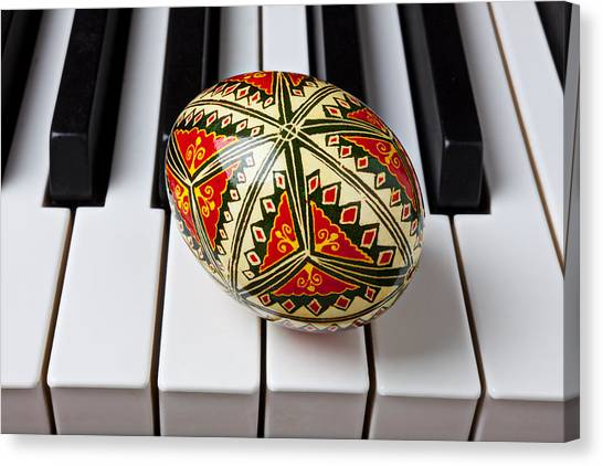 Easter Eggs Canvas Print - Painted Easter Egg On Piano Keys by Garry Gay