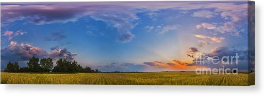 Prairie Sunsets Canvas Print - Panorama Of A Colorful Sunset by Alan Dyer