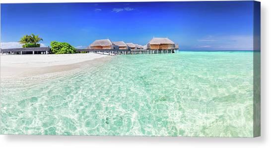 d69ccafa291 Maldivian Canvas Print - Panorama Of Wide Sandy Beach With Water Villas On  A Tropical Island