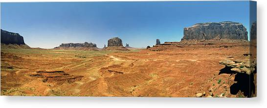 Panoramic View Of The Monument Valley  Canvas Print by George Oze