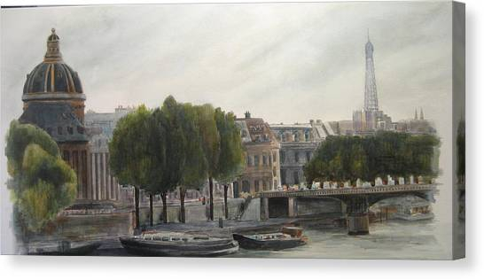 Paris Across The Seine Canvas Print by Victoria Heryet