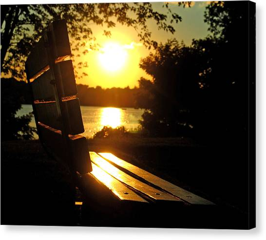 Park Bench At Sunset Canvas Print