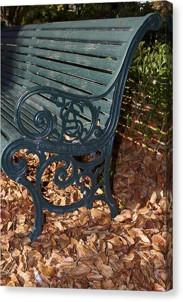 Park Bench In Autumn Canvas Print by Geoff Bryant