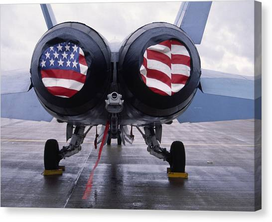 Patriotic American Flag Covers On The Rear Of An American F/a-18 Hornet Fighter Combat Jet Aircraft. Canvas Print