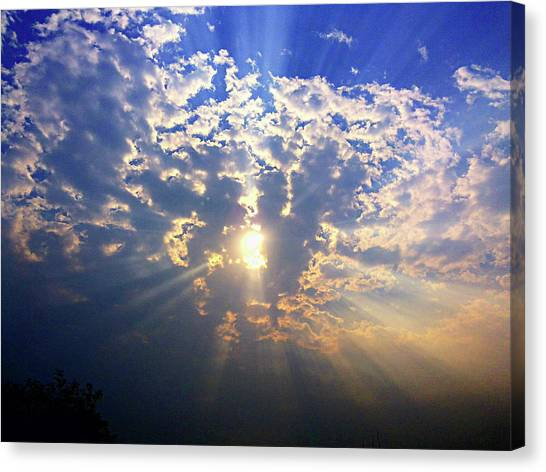 Peaking Behind The Clouds Canvas Print