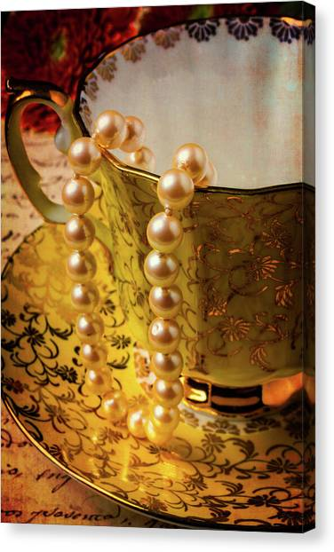 Tea Time Canvas Print - Pearls Hanging Off Tea Cup by Garry Gay
