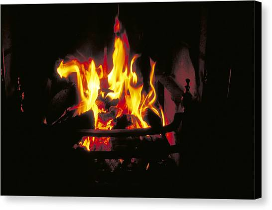Peat Fire In Ireland Canvas Print by Carl Purcell