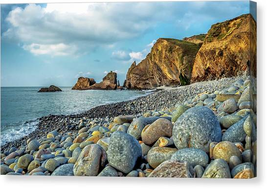 Canvas Print featuring the photograph Pebbles On The Beach by Nick Bywater