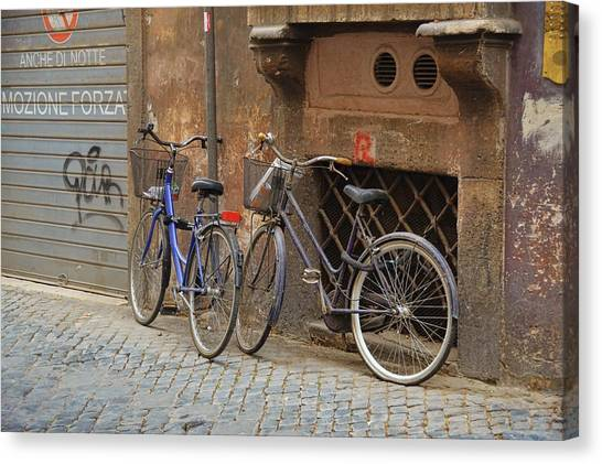 Bicycling Thru Rome Canvas Print by JAMART Photography