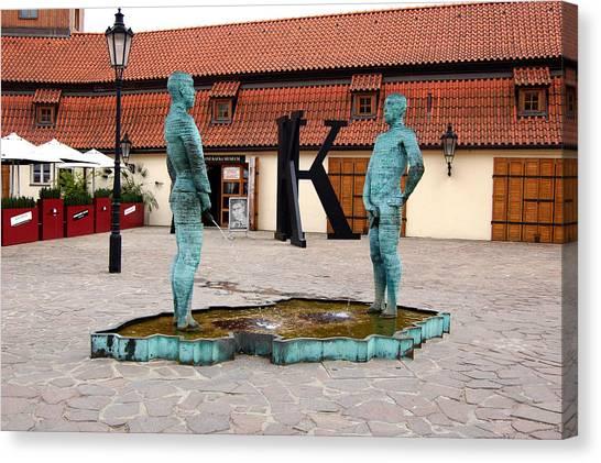 Peeing Men Kafka Museum Prague Czech Republic Canvas Print by Wayne Higgs