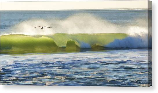 Pelican Flying Over Wind Wave Canvas Print