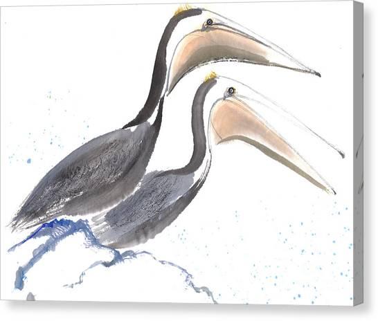Pelicans Canvas Print by Mui-Joo Wee