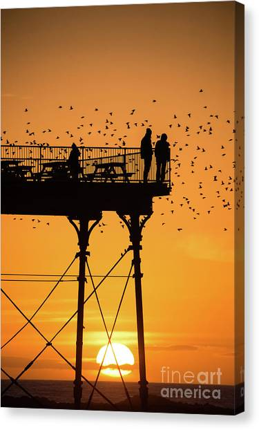 People On The Pier Sunset And Starlings In Aberystwyth Wales Canvas Print