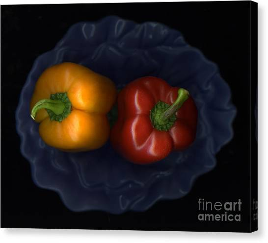 Peppers And Blue Bowl Canvas Print