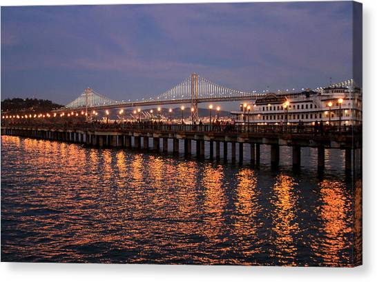 Pier 7 And Bay Bridge Lights At Sunset Canvas Print