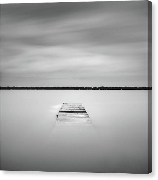 Canvas Print featuring the photograph Pier Sinking Into The Water by Todd Aaron