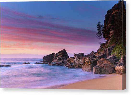 Pink Clouds And Rocky Headland Seascape Canvas Print