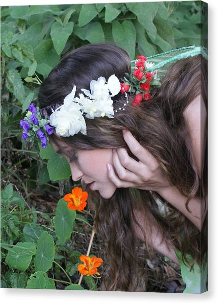 Pixie Smelling A Poppy Canvas Print