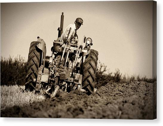 Ploughing Canvas Print